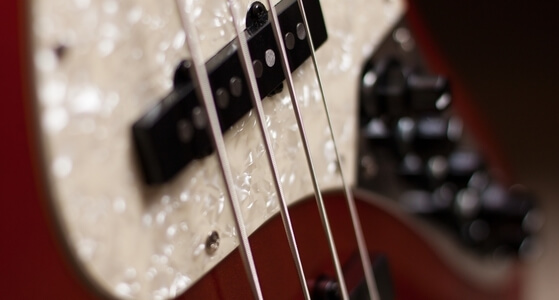 red bass guitar, pearl like scratchplate